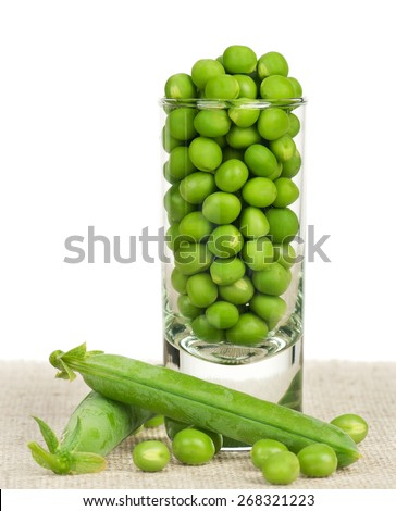 Fresh green peas in a glass isolated on white background - stock photo