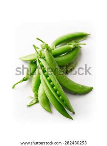 fresh green peas isolated on a white background - stock photo