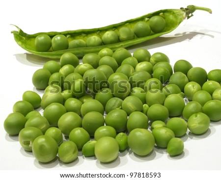 fresh green peas on a white background - stock photo