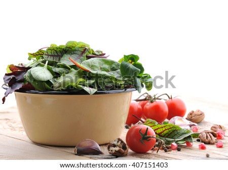 Fresh green salad. Vegetables and spice for salad. - stock photo
