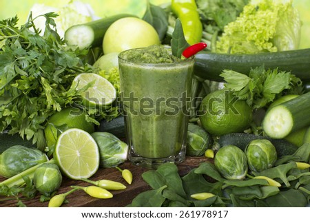 Fresh green Smoothie made with organic vegetables and limes - stock photo