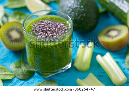 fresh green smoothie on wooden surface - stock photo