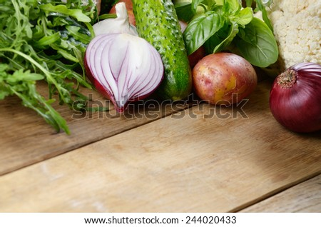 Fresh green vegetable set on the wooden table - stock photo