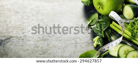 Fresh green vegetables on vintage background - detox, diet or healthy food concept - stock photo