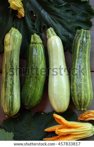 fresh green zucchini on wooden background - stock photo
