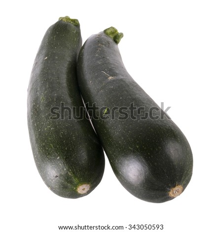 Fresh green zucchini vegetables on white background - stock photo
