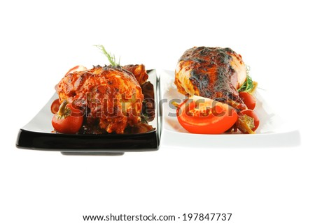 fresh grilled drumstick on plates with vegetables - stock photo