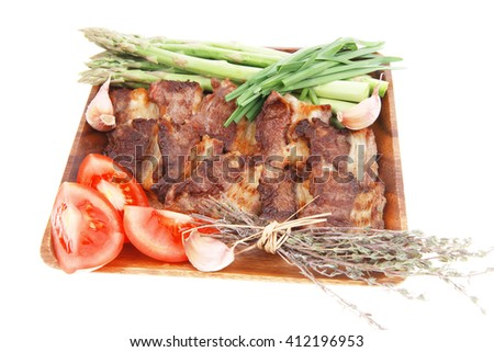 fresh grilled meat beef ribs with asparagus thyme and tomatoes on wooden plate isolated over white background - stock photo