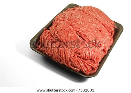 Fresh ground beef on a styrofoam tray. - stock photo
