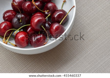 Fresh  group of  red cherries in white bowl. Top view of ripe healthy cherry. - stock photo