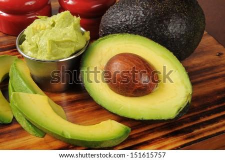 Fresh guacamole with avocado slices - stock photo