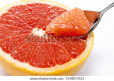 fresh half grapefruit to eat scoop with a spoon - stock photo