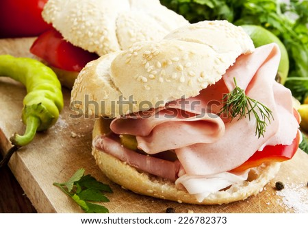 Fresh Ham Sandwiches with Pepper, Dill and Parsley on Wooden Board - stock photo