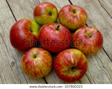 fresh harvested apples on wooden background - stock photo