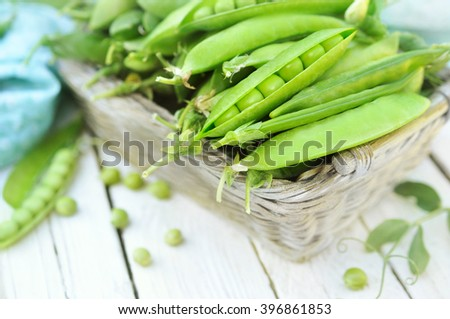 Fresh harvested green peas with pods - stock photo
