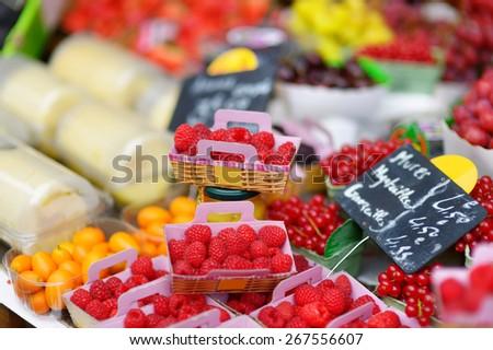 Fresh healthy bio raspberries on Paris farmer agricultural market - stock photo