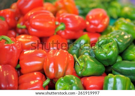 Fresh healthy bio red and green paprika on Paris farmer agricultural market - stock photo
