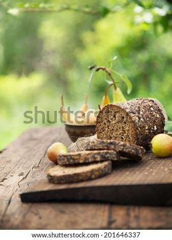 Fresh healthy bread on wood. Breakfast with bread and fruit - stock photo