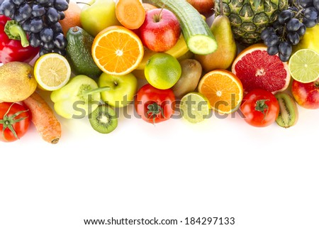 Fresh, healthy fruits and vegetables on white.  - stock photo