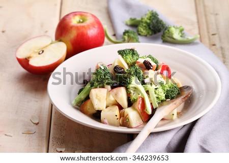 Fresh healthy salad with broccoli and apple - stock photo