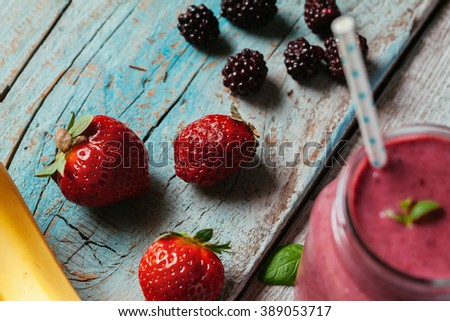 Fresh Healthy Smoothie Made Of Banana And Berries. Focus Is On Fruit - stock photo