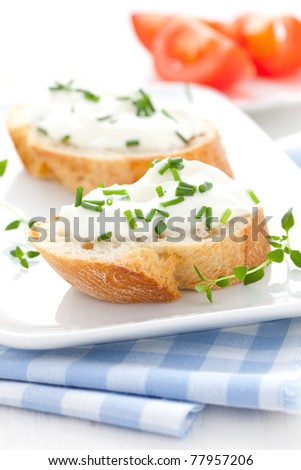 fresh herb cheese on baguette - stock photo