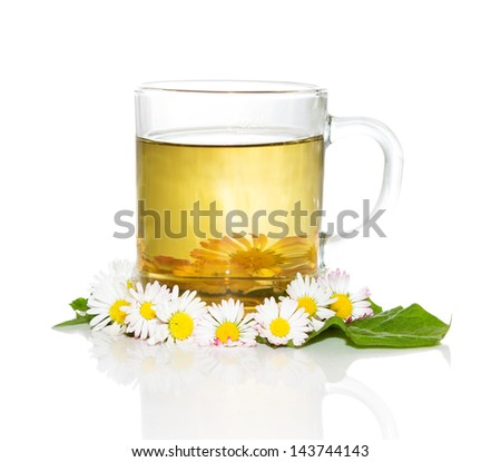 Fresh herbal tea or infusion, from Bellis prennis, for naturally detoxifying the body in the springtime - stock photo