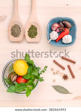 Fresh herbs and spices sage,rosemary,parsley,mint ,holy basil ,nutmeg,star anise ,cinnamon stick,oregano,thyme ,dill and chili on wooden table. Top view with copy space. - stock photo