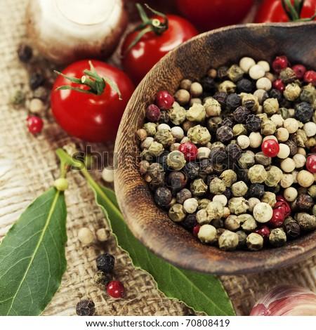 Fresh herbs and spices (tomatoe, garlic, pepper, mushroom, bay leaves) - stock photo
