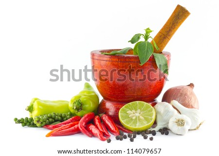 Fresh herbs and spices with wooden mortar isolated on white background - stock photo