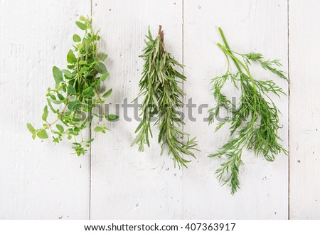 Fresh herbs on wooden background, close-up. - stock photo