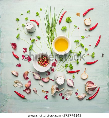 fresh herbs ,spices and cooking oil composing on rustic background, top view - stock photo