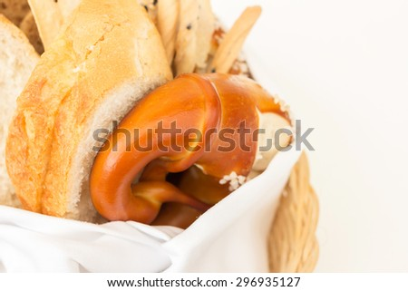 Fresh home made bread in wicker basket  - stock photo