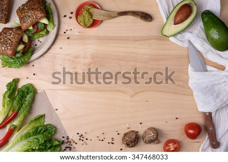 Fresh homemade burgers with shiitake on a wooden table with ingredients, top view, copy space.  - stock photo