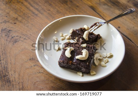 Fresh Homemade Chocolate Brownie on the wooden background - stock photo