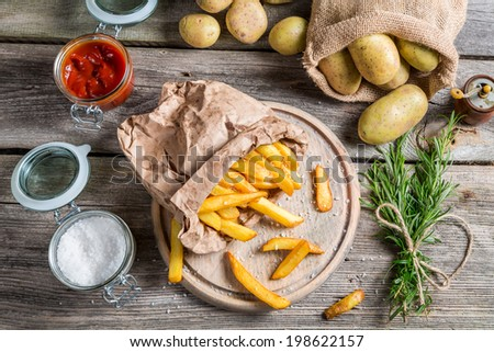 Fresh homemade fries with salt and ketchup - stock photo