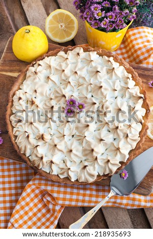 Fresh homemade lemon meringue pie on the table - stock photo