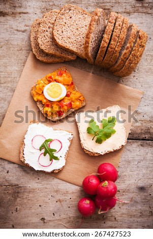 Fresh homemade meal with bread and vegetarian spread - stock photo