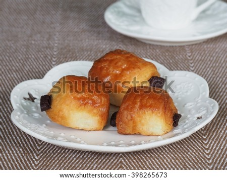 Fresh Homemade Of French Chocolate Bread Or Chocolatines On White Plate - stock photo
