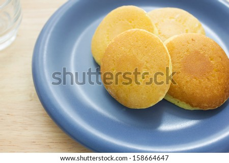 Fresh Homemade Pancakes stack in blue plate on table - stock photo