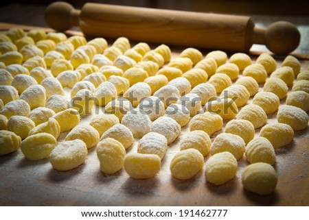 Fresh homemade potato gnocchi ready for cooking - stock photo