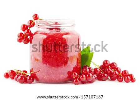 Fresh homemade red currant jam with currants on white - stock photo