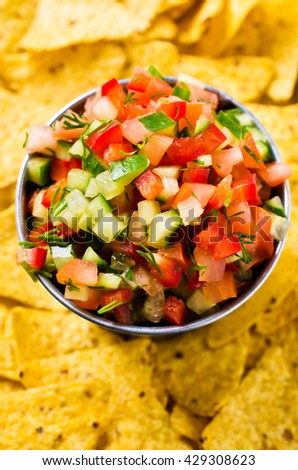 Fresh homemade salsa with vegetables and chips nachos. Selective focus. - stock photo