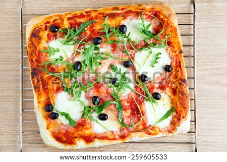fresh homemade square pizza just out of oven - stock photo