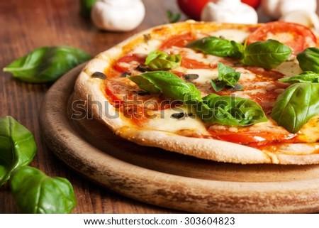 Fresh homemade vegetarian pizza - stock photo