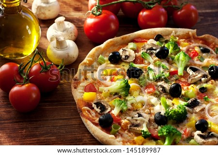 fresh homemade veggie pizza with vegetables - stock photo