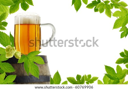 Fresh hop frame with vintage glass of beer on old barrel, isolated on white background - stock photo