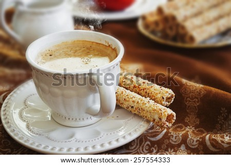 fresh hot cup of morning coffee and cookies on the table.selective focus - stock photo