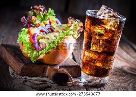 Fresh hot dog with vegetables and sausage - stock photo