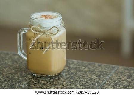 Fresh ice coffee in big glass - stock photo